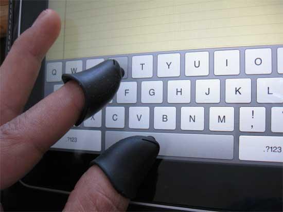 fingers on iPad