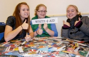 WordPress Jobs-Young writers at a Write+Aid table