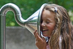 WordPress Notifications-Girl listening to playground ear trumpet