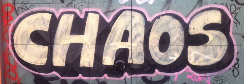 The word chaos graffitied onto a wall