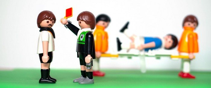 Photo of Lego soccer scene with player receiving a red card from the referee