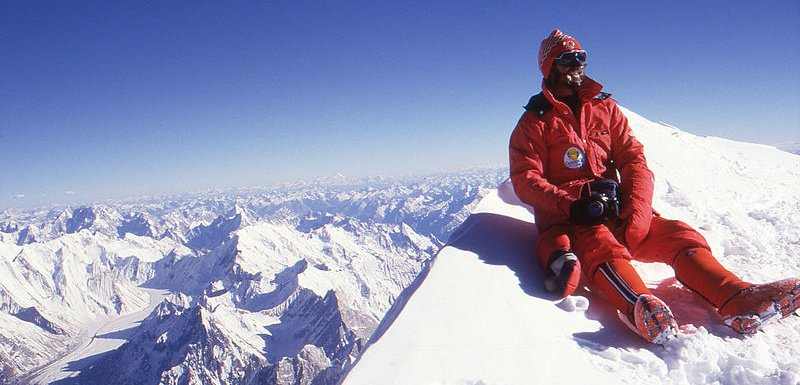Mountain climber at the summit of K2