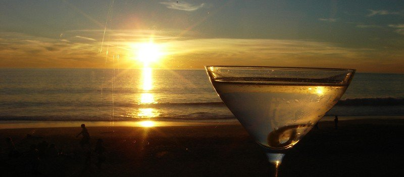 Photo Of A Sunset Over A Beach With A Martini