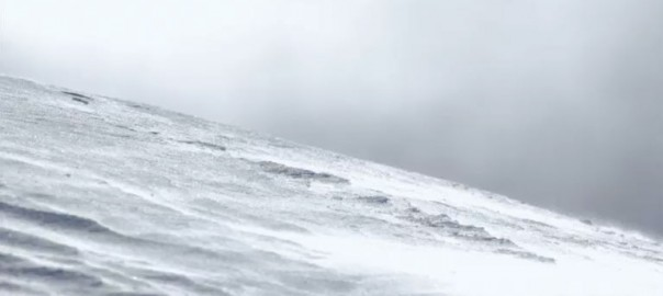 A photo of a windswept snowy lanscape.