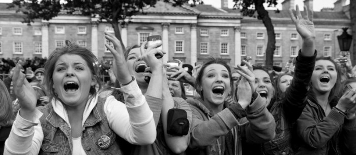Photo of girls clapping and cheering