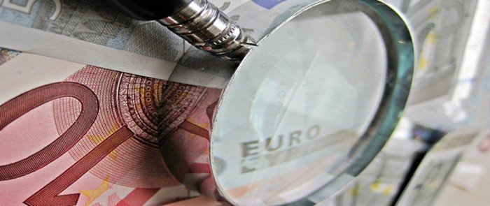 Magnifying glass on top of euros