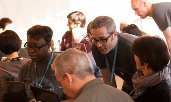 people using laptops at a WordCamp