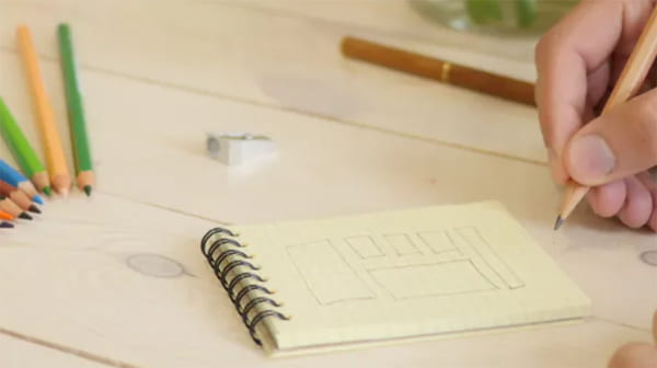 Planning a website using a pencil and a notepad
