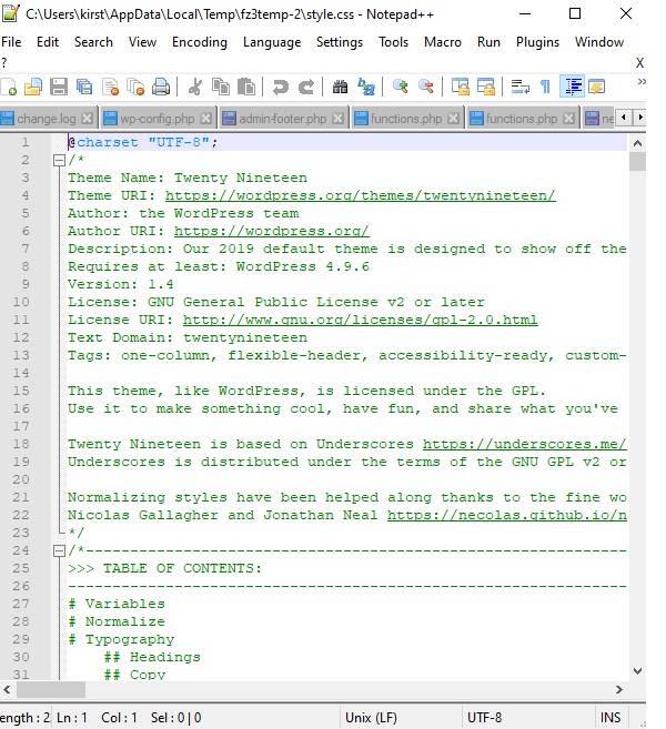 Showing the opened style.css file inside the Notepad ++ text editor application.