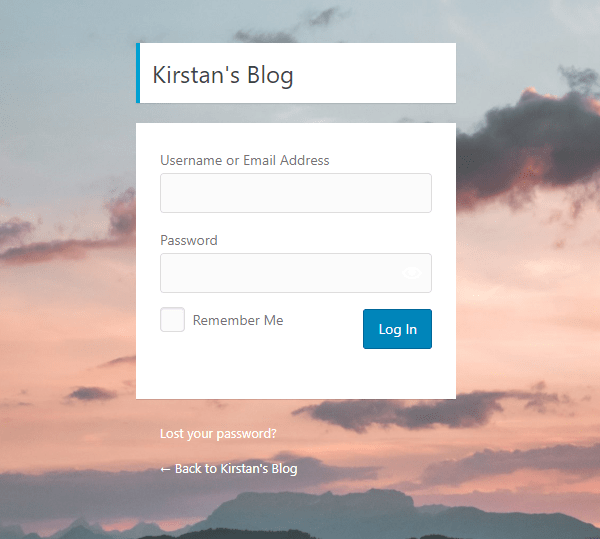 Screenshot of a customized login screen with a background image showing a sunset.