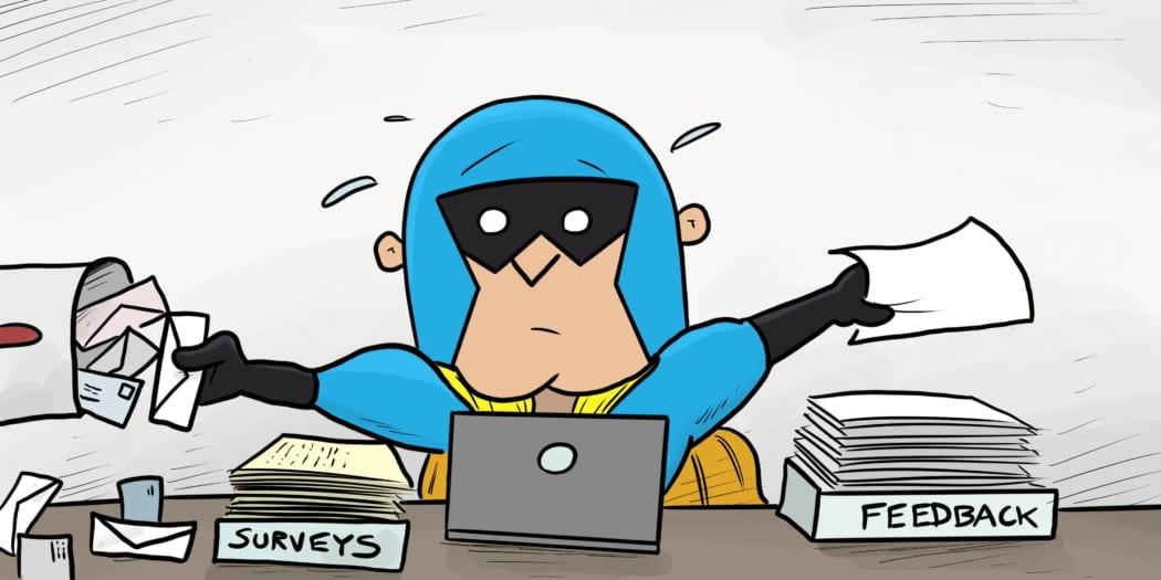 Image showing Dev Man sorting through feedback, flustered at his desk