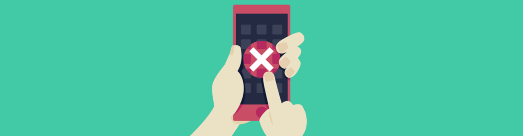 Image showing hands holding a phone with a huge cross through the screen